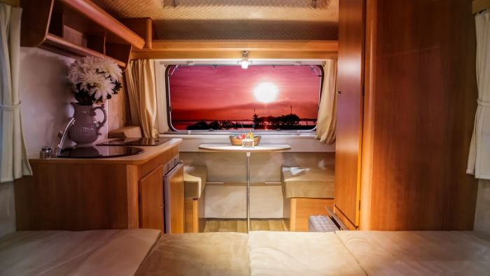 view of sunset through back window of caravan australia